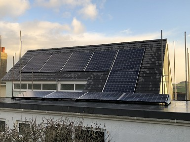 new roof with the re-installed pv panels
